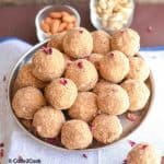 aate ke laddu served in a big plate with cashew almond & wooden spoons.