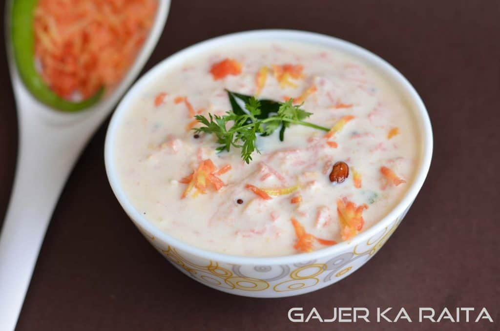 Carrot raita or gajar ka raita is prepared by mixing grated carrot in curd with some spices. It is great to have with stuff parathas instead of simple curd.