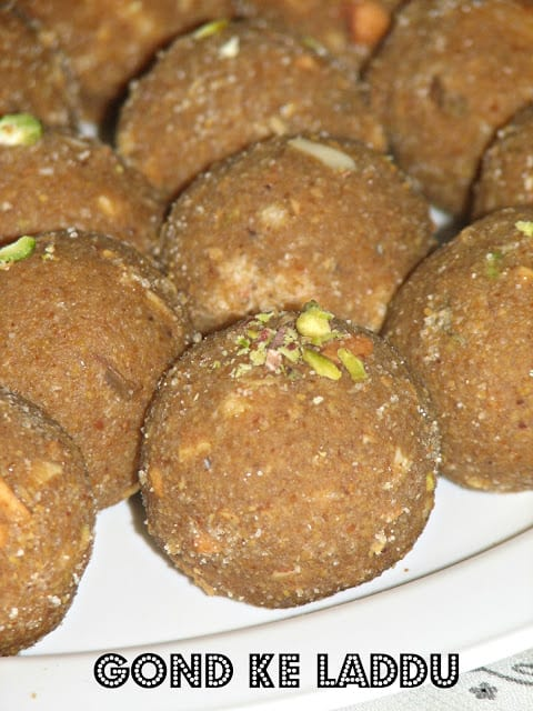a close up click of gond ke laddu with sugar