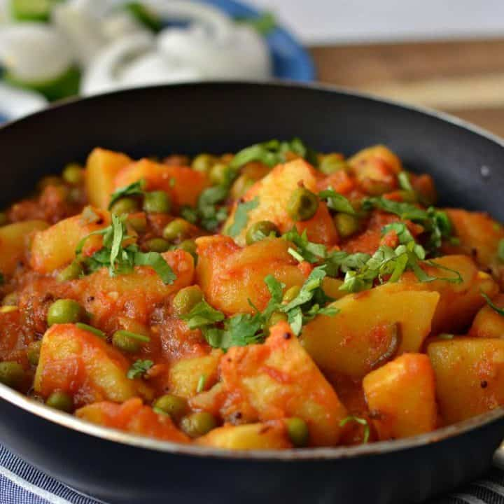 Aloo Matar is a simple, spicy, tangy potato and green peas curry. Serve with any kind of flatbread and rice recipe to enjoy this vegan aloo matar best.