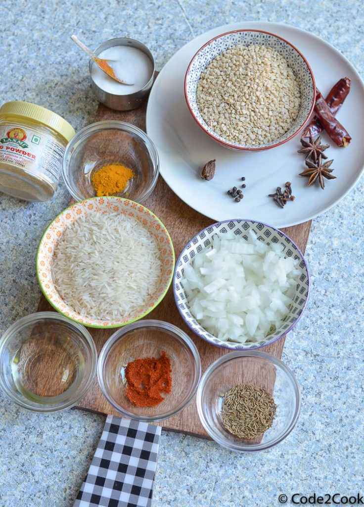 white urad dal ingredients shown on a wooden board