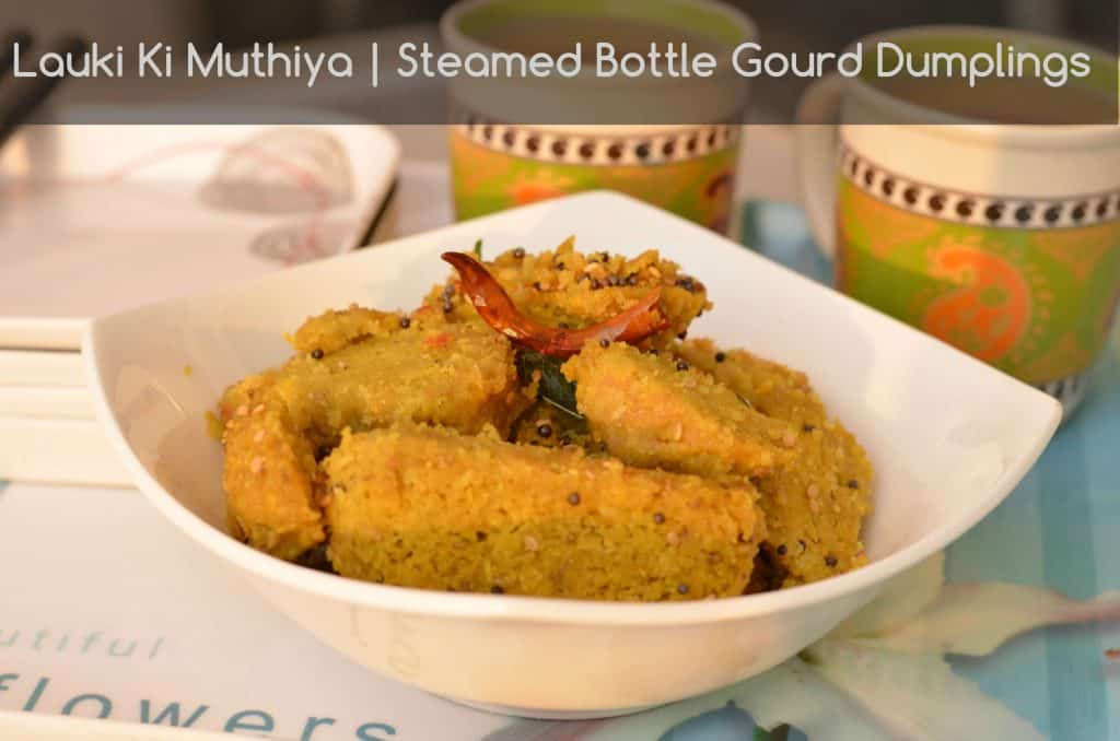 Lauki Nu Muthia or lauki muthia or bottle gourd's steamed dumplings is a popular Gujarati tea time snack, having less oil but very tasty and nutritious. Muthi means fist, this snack is named as muthia because we have to shape them in a cylindrical shape with the help of fist. Lauki Nu Muthia is a very healthy snack as it is steamed. You can shallow fry as well if needed.