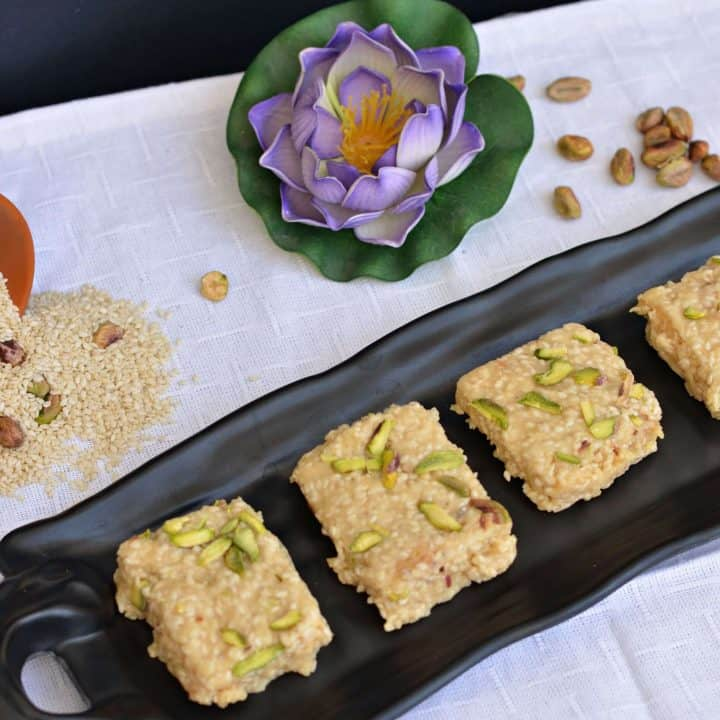 """Til Bugga is a traditional dessert prepared on Makar Sankranti in North India. Specially prepared in winter season named as """"Til Bugga"""". It consists of dry roasted sesame/til seeds with mava/evaporated milk and sugar. Only with these ingredients, such a delectable dessert get ready in few mins."""