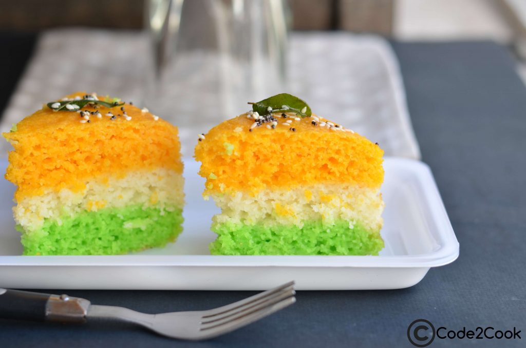 Tri-Color Dhokla is a popular Gujarati snack. It is a steamed & spongy snack tempered with mustard seeds and sesame seeds. This delightful tri-color dhokla is so simple to make. Since dhokla is steamed version so it is healthy as well. You can avoid oil tempering if you are weight conscious.