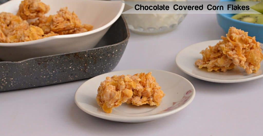 Chocolate corn flakes are very easy to make and loved by kids. With just melted chocolate and readymade corn flakes, even kids can make them. If you run out of kids cereal then chocolate corn flakes come very handy. It is such a quick and easy recipe which require no baking.