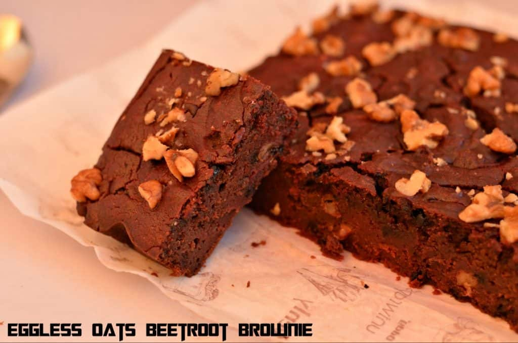 Eggless Oats Beetroot Fudge Brownie is the combination of very healthy ingredients like oatmeal and iron-rich beetroot puree. Beetroot is known as a rich source of iron than any other property whereas oats are considered to be the healthiest grain these days. This is gluten-free and a great source of many minerals, antioxidants, vitamins and rich in fiber. I prepared these brownies to keep them as healthy as possible by adding such ingredients. A great post or pre-workout snack for me and good for kids too.