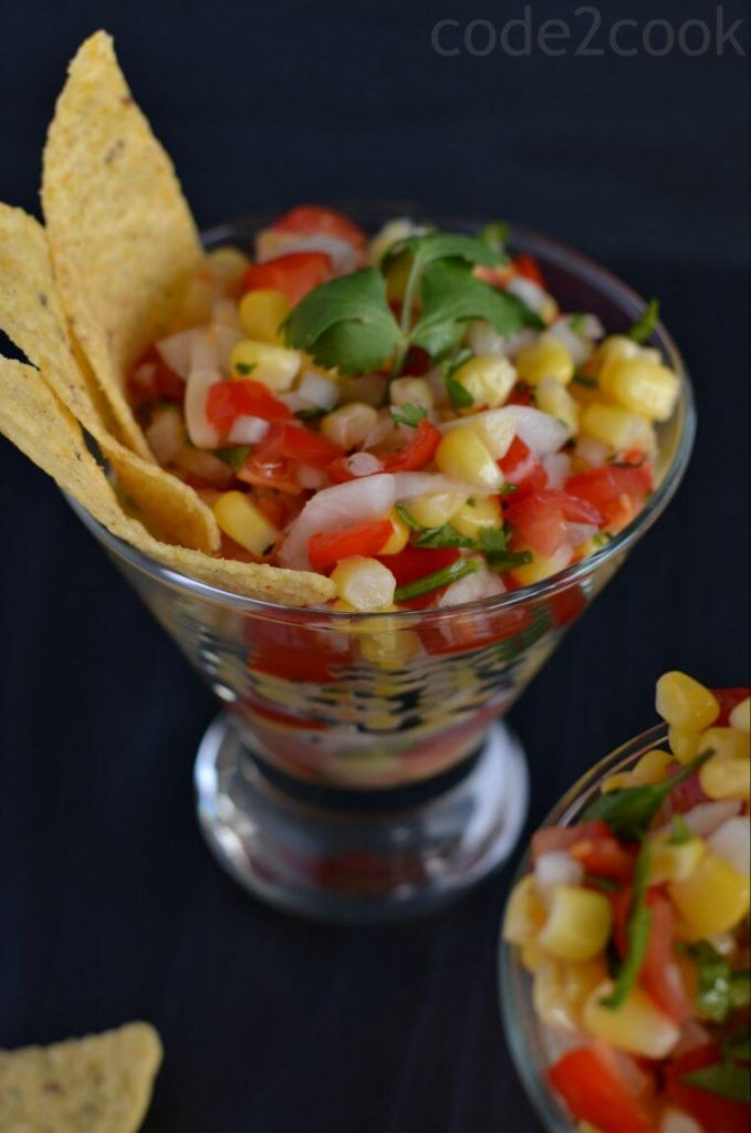 This corn salsa is quite easy to make, combining sweet corn, chopped tomato, onion, serrano chili, cilantro and a dash of lime juice. This is a perfect recipe for nachos or adds on in a burrito bowl. Even it is a kind of salad which will go perfectly for snack time or with your rice recipes.