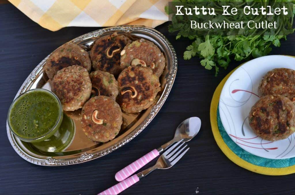 overhead shot of Kuttu ki Tikki or buckwheat cutlet served with chutney and cutlery.