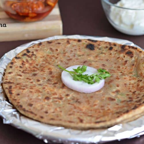 Mooli paratha or radish paratha is an Indian flatbread stuffed with grated radish. Stuffing is spiced up with few spices and then stuffed in whole wheat dough portions. These parathas make a wholesome meal for breakfast, lunch or dinner.