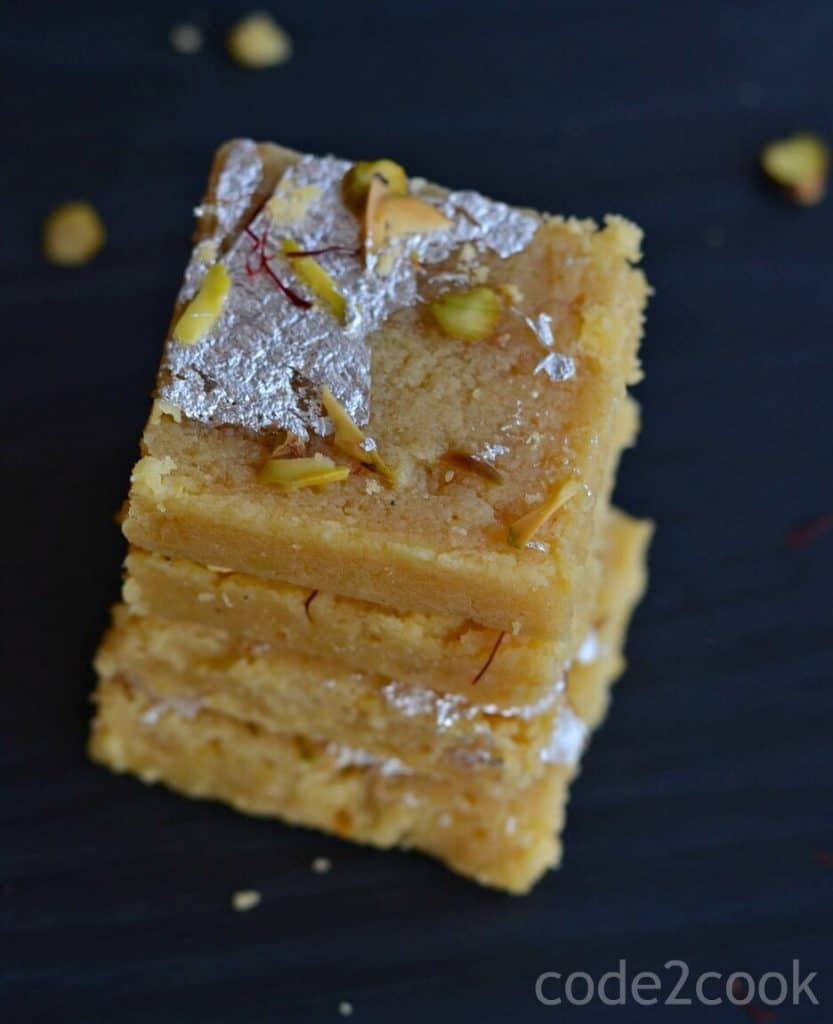 Moong Dal Barfi is a traditional Indian delicacy prepared with moong dal or yellow lentil. This is a fudgy, grainy sweet and a bit tricky to make at home. Yellow lentil is gluten-free so this barfi is perfect for those who are allergic to gluten.