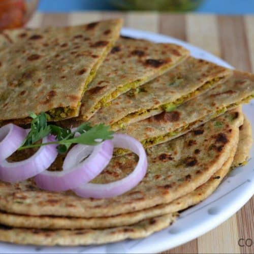 Peas paratha or Matar ka paratha is a delicious Indian flatbread, where whole wheat soft dough ball is stuffed with mashed green peas.This paratha is easy, healthy, and very nutritious. Peas paratha taste great if peas stuffing is little spicy as peas have little sweet taste. Peas paratha is the perfect dish for breakfast or in any meal accompanied with raita and pickle.