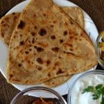 Ajwain paratha is a simple Indian flatbread served with curry, dal or simply pair up with curd or pickle. Even you can have them with tea which makes a perfect combo altogether. Apart from ajwain paratha, you can make ajwain poori and ajwain roti with the same dough. They are great for breakfast or dinner and lunch.