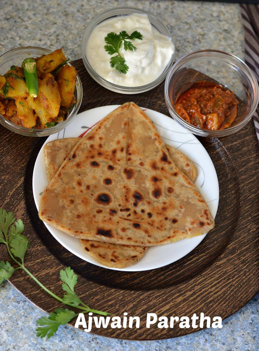 Ajwain paratha served with aloo sabji, curd and pickle.