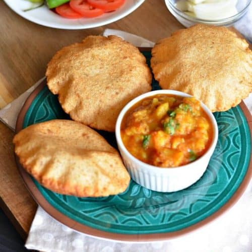 Urad dal poori or bedmi poori is a popular Indian street food and now an integral part of most Indian kitchens must say. Bedmi poori is served hot with spicy, tangy potato gravy with a pickle in North India.It is a deep fried whole wheat flour flatbread mixed with a spicy mixture of urad dal (lentil).