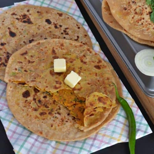 Besan paratha or masala besan paratha is a wonderful Rajasthani paratha recipe which is prepared by stuffing spicy besan or gram flour filling in the whole wheat dough. This paratha is crispy, aromatic and filled with the pickled flavor besan stuffing makes a wholesome meal.