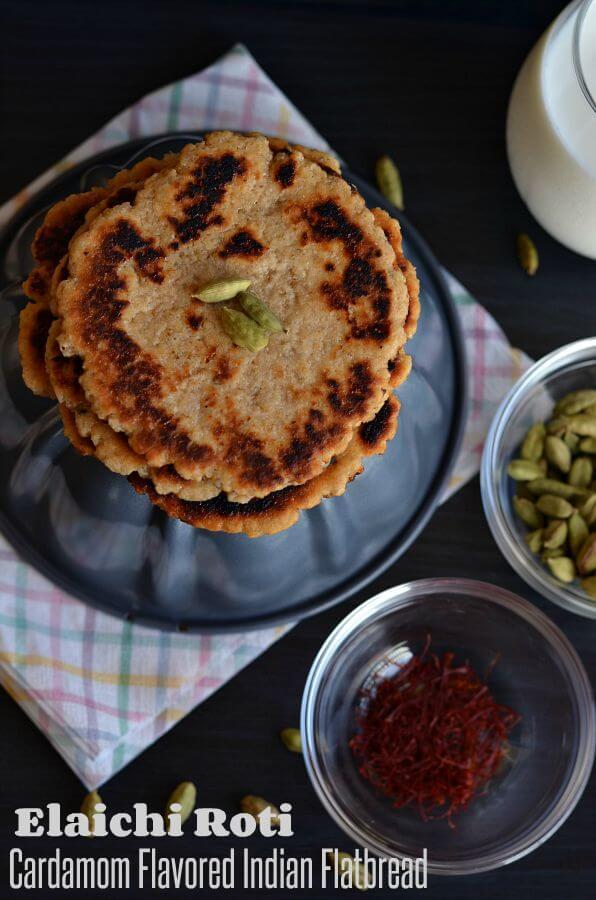 sweet paratha or cheeni ka paratha stacked over grey bowl.