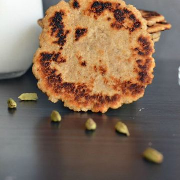 Elaichi roti or cardamom flatbread is a very simple Indian flatbread which can be prepared in a jiffy whenever you crave for something sweet. In whole wheatflour added sugar granules, flavored with saffron strands and cardamom, kneaded using milk. This bread is sweet, crispy, and thick in texture. Elaichi roti tastes great if taken with milk.