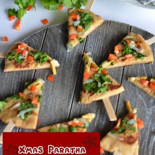 Xmas paratha, basically a whole wheat yeast flatbread which is kneaded with dry fruits powder. Further added cheese, bell pepper, green coriander then cut into Christmastreeshape