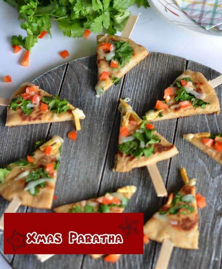 Xmas paratha, basically a whole wheat yeast flatbread which is kneaded with dry fruits powder. Further added cheese, bell pepper, green coriander then cut into Christmas tree shape