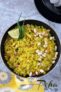 Indori poha recipe which is a famous street food and a staple breakfast in Madhya Pradesh. Indori Poha Sprinkled with sev or bhujiya and served with jalebi is the unique combination which makes it stand out.