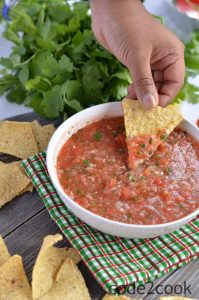 Tomato salsa is one of the most popular Mexican side dish served with tortilla chips. It is tomato based sauce and great with chips, tacos, burritos, and wraps.