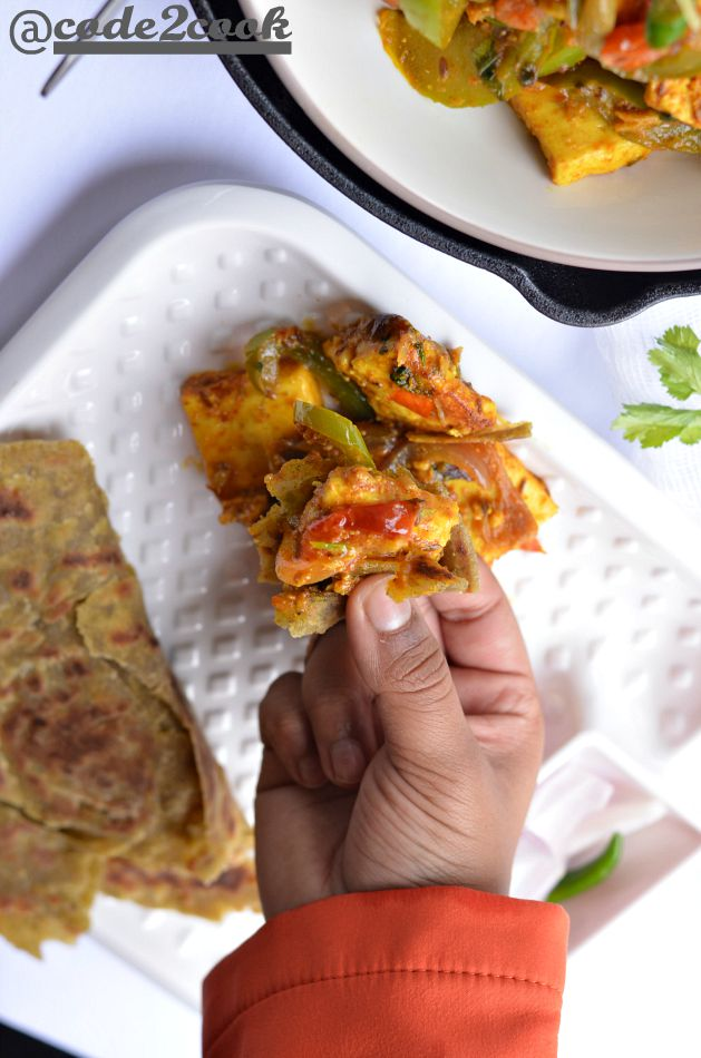 pudina laccha paratha is served with paneer jalfrezi.
