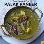 palak paneer is served in copper kadhai with red chili tempering