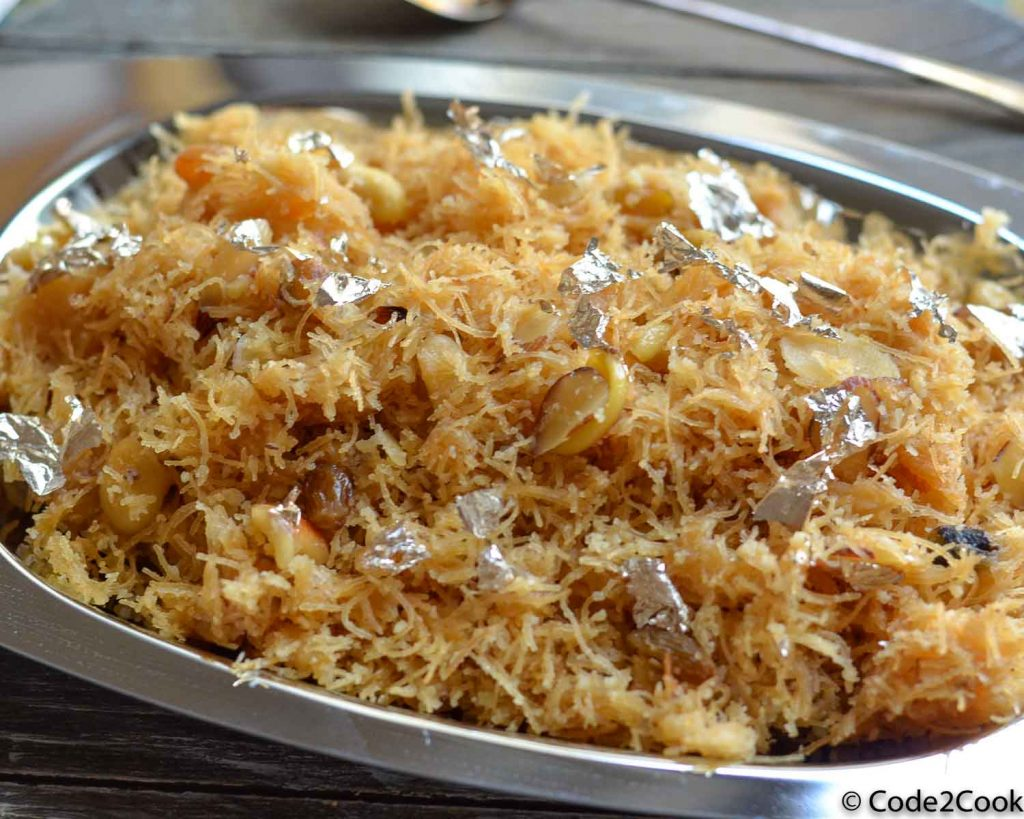 sweet vermicelli served in a steel plare. A close up click.