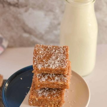 macadamia nut bars are stacked and placed over cookie stand.