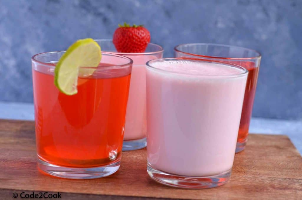 four roohafza drinks served in glass.