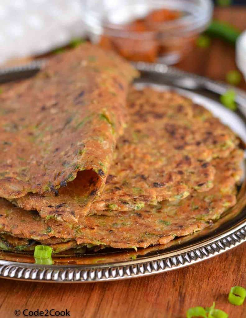 a close up click of spring onion paratha