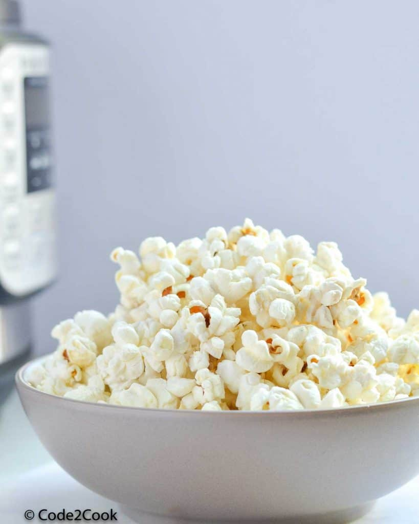 a bowl filled with popcorn made in instant pot.
