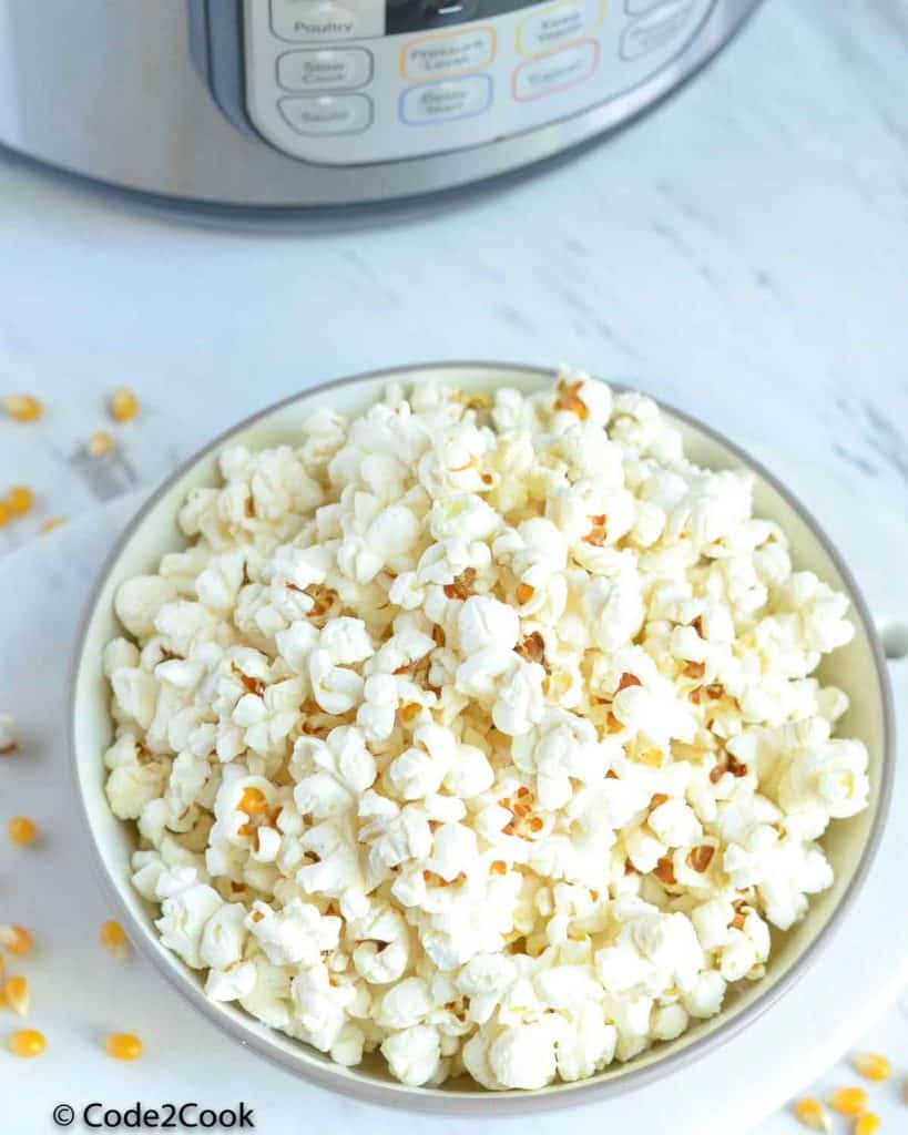 popcorn served in a bowl in front of instant pot