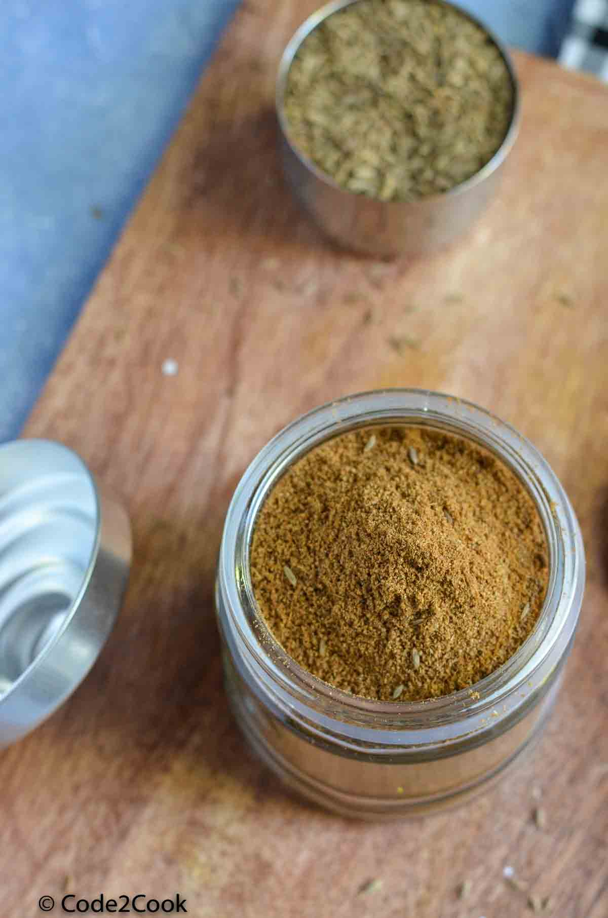 cumin seed powder in a glass jar