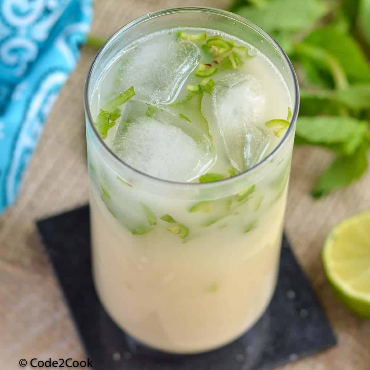 close up of sattu drink or sattu sharbat in glass with ice cubes.
