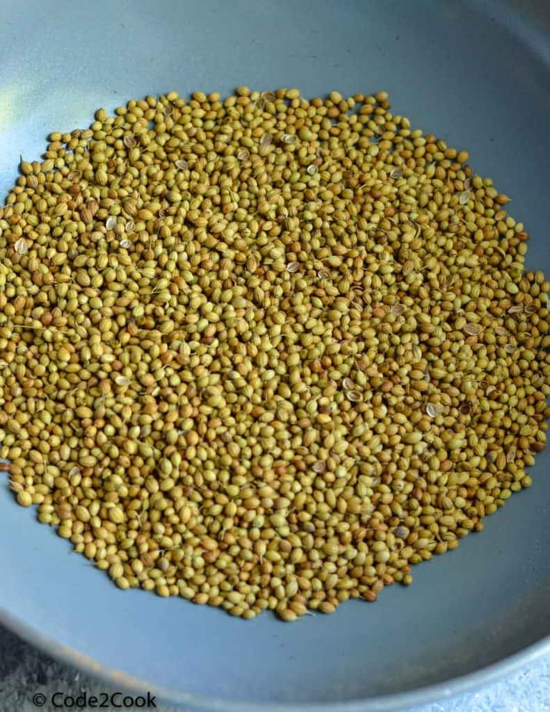 roasting coriander seeds in kadai.
