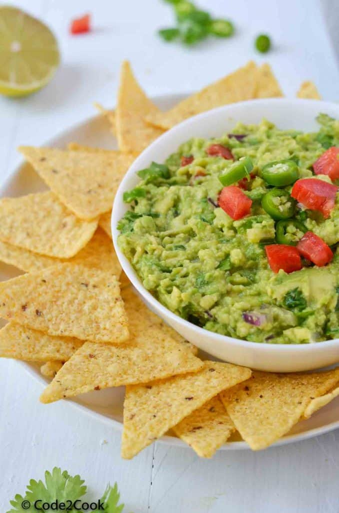 side view of guacamole with nachos