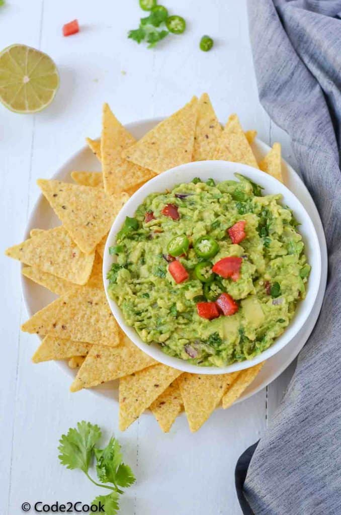 simple guacamole served with nachos