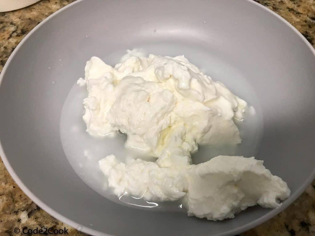 Whisking yogurt with water