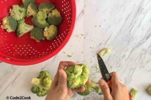 cutting broccoli in medium sized florets