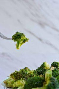 broccoli floret stuck in fork